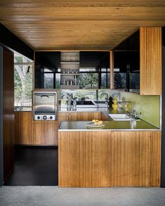 Wood kitchen design ideas in black with wooden ceilings