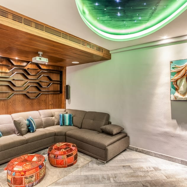 false ceiling design ideas for living room with projector wood accents and round cutout with stars painted