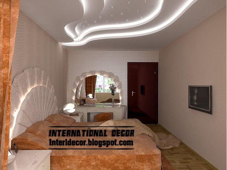 Stylish Waves in false ceiling in white bedroom with large mirror