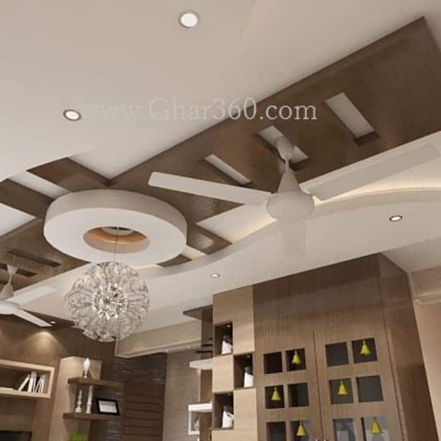 false ceiling design ideas for living room with dark colors and white fan and decor