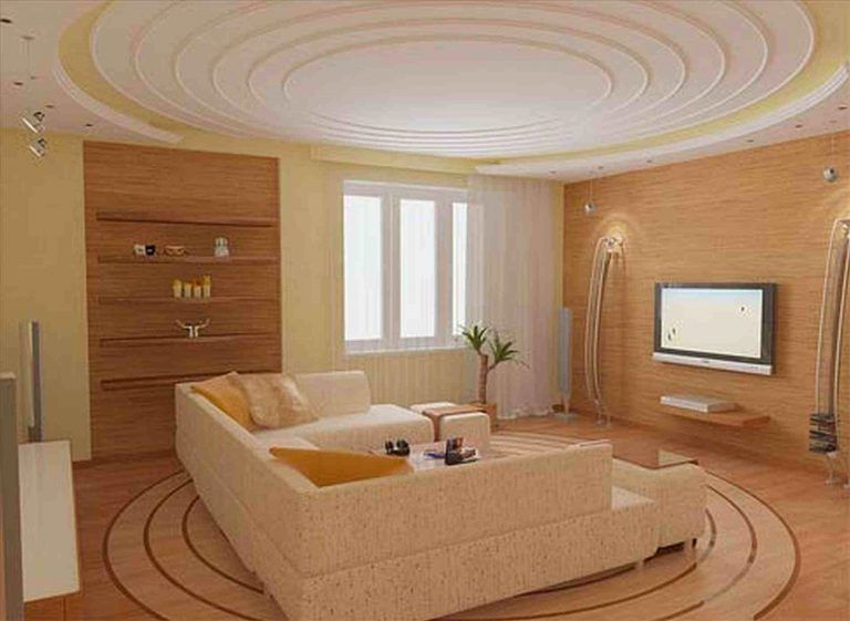 Artistic circular ceiling design in living room with yellow and wood accents
