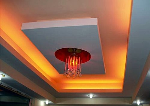 Chandelier with red lights as part of ceiling design