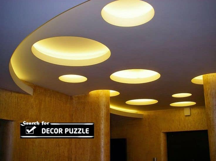 false ceiling design ideas for living room with cutout circular shapes and yellow lighting