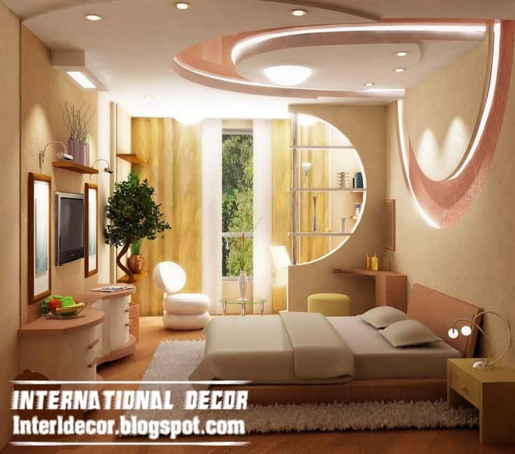 Pink heart shaped ceiling in bedroom with tv and other decor