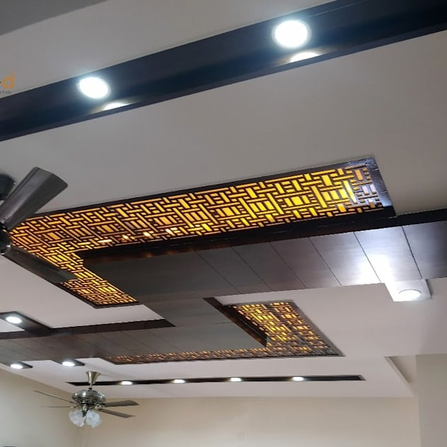 Jali work on false ceiling with wood accents