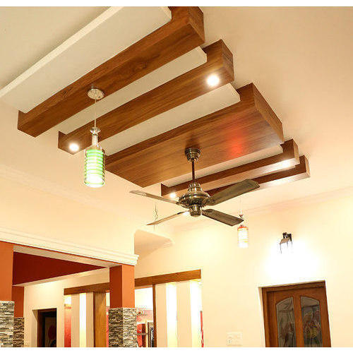 Wooden False Ceiling with fan in large room with pendant lights