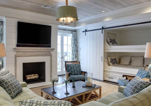 Beach House Walkout Basement Ideas in white and blue with large tv