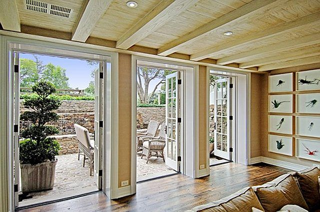 Airy basement with tree and outdoor furniture on patio
