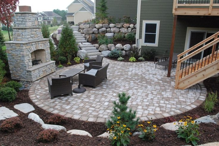 Large patio with outdoor furniture, fireplace and great landscaping