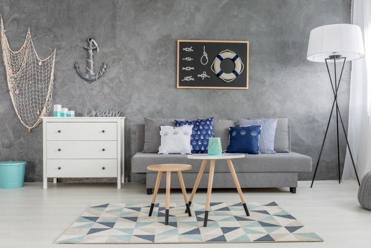 Nautical Decor with dresser in gray room with other furniture