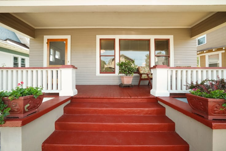 Red Porch with planters and white rails