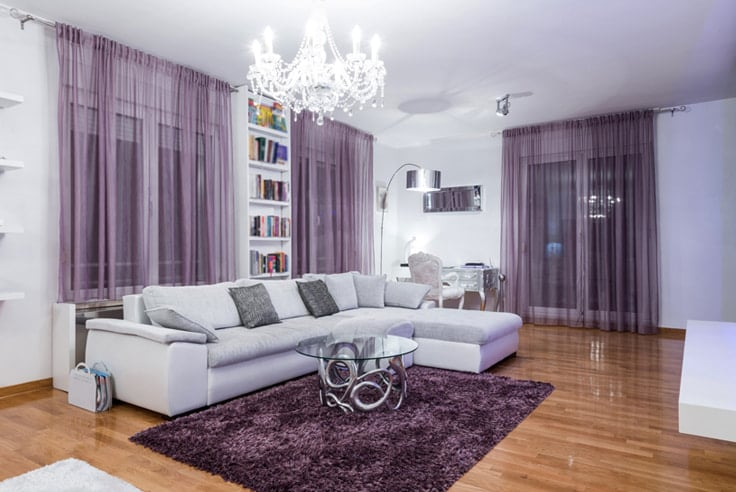 White room with purple accents and white couch