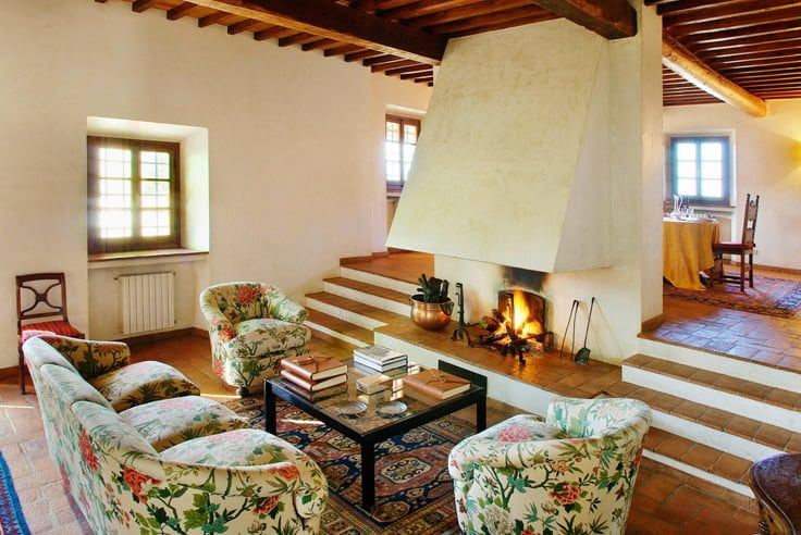 Fireplace Built-Ins with brown tiled floor with wood accents and floral pattern on furniture