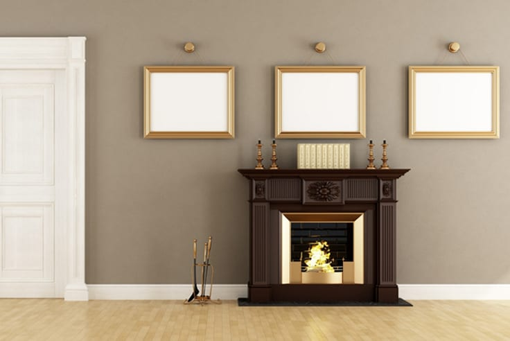 Brown fireplace built in with wood flooring and gold decor