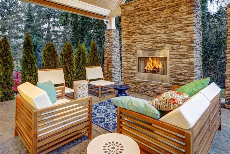Outdoor fireplace with wooden outdoor furniture