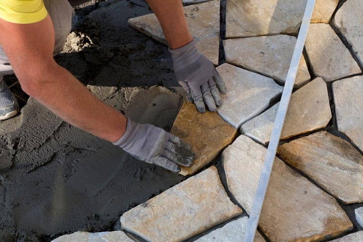 Replace any chipped or broken pavers