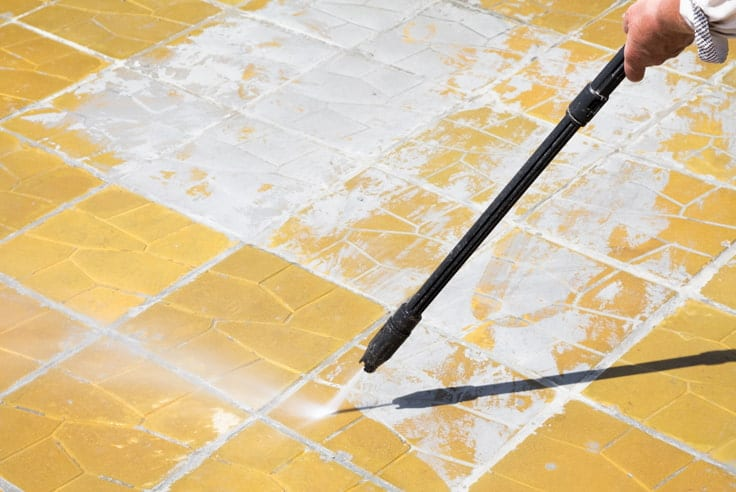 cleaning with pressure washer