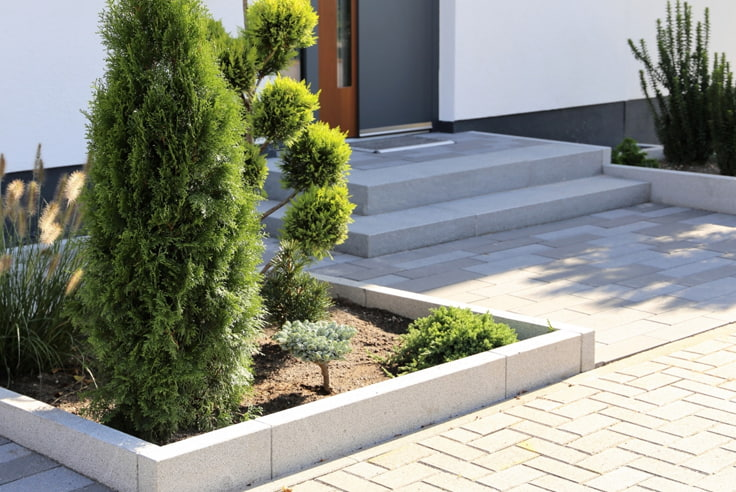 Grey pavers with landscaping